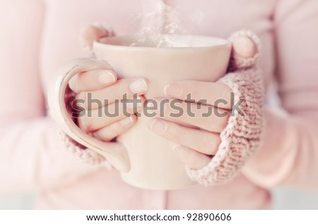 Woman holding tea cup.