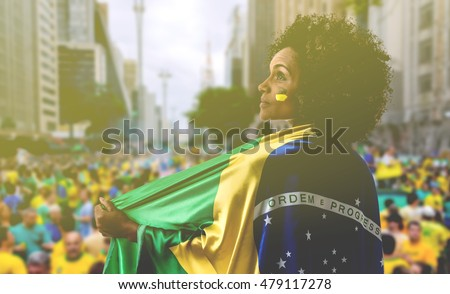 Woman holding the flag of Brazil in Sao Paulo #479117278