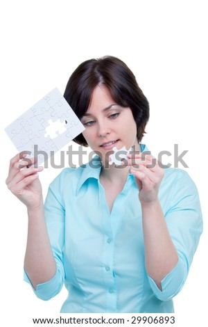 Woman holding the missing piece of a jigsaw puzzle, isolated on white background.