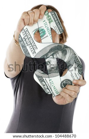 woman holding the symbol of the dollar made ??a $ 100 bill