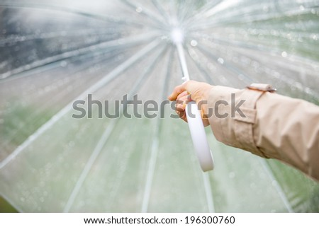 Woman holding umbrella. focus on hand