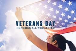 woman holding United States of America flag on sunny sky. Veterans day. Honoring all who served.