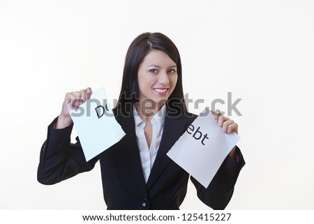 woman holding up a piece of paper with the word debt written on it and tearing the sheet of paper in half