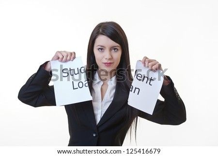 woman holding up a piece of paper with the words student loan written on it and tearing the sheet of paper in half
