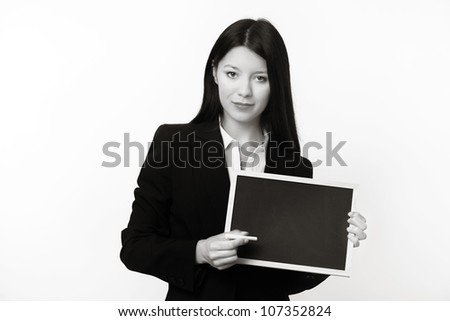 woman holding up a small blank black board ready to write something on