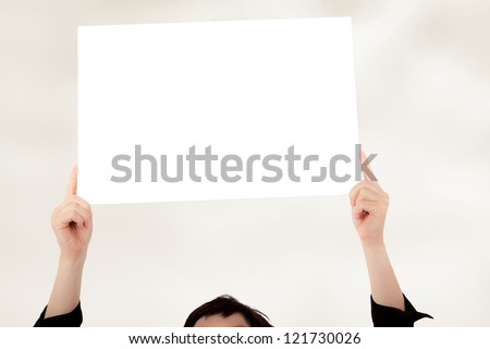 Woman holding up blank poster