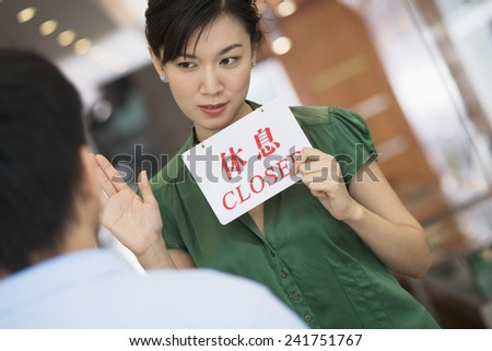 Woman Holding Up \