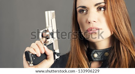 woman holding up her weapon