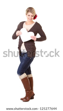 woman holding white heart full length isolated on white