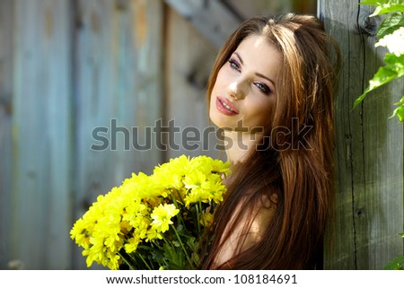 Woman holding yellow flowers . outdoor shoot
