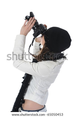 woman holds a camera