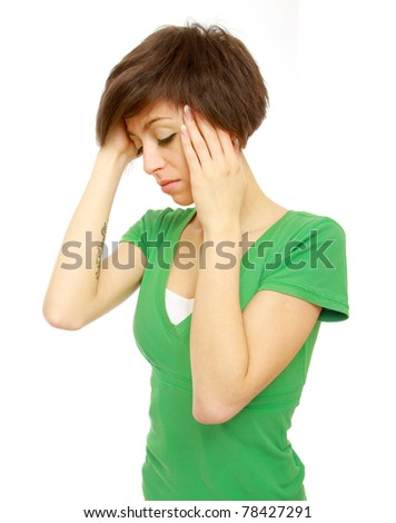 Woman holds head with pain