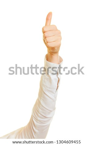 Woman holds her thumbs up as success and approval symbol