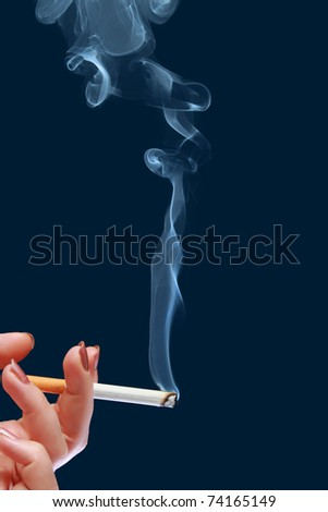 Woman holds in her hand cigarette which produce smoke