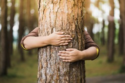 Woman hug the tree with love