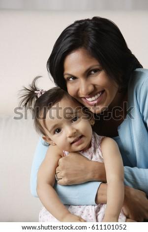 woman hugging her baby #611101052