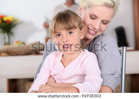 Woman hugging her daughter