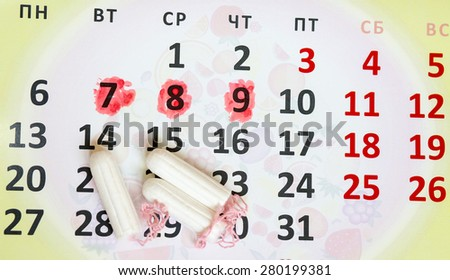Woman hygiene protection, close-up.menstruation calendar with cotton tampons,Sanitary pads