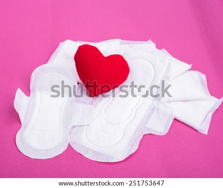 Woman hygiene protection (sanitary) on paper background