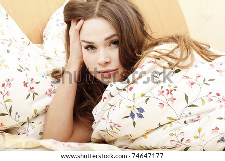 Woman in a bed before or after sleep