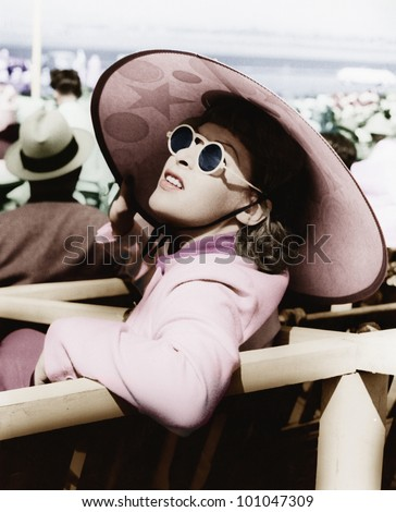 Woman in a big sun hat and sun glasses