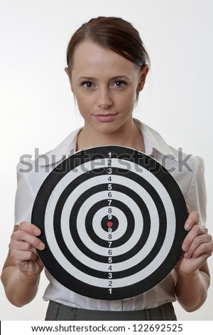 woman in a business out fit holding up a target