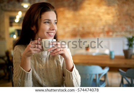 woman in a cafe drinking coffee #574474078