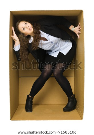 Woman in a cardboard box isolated on white background - stock photo