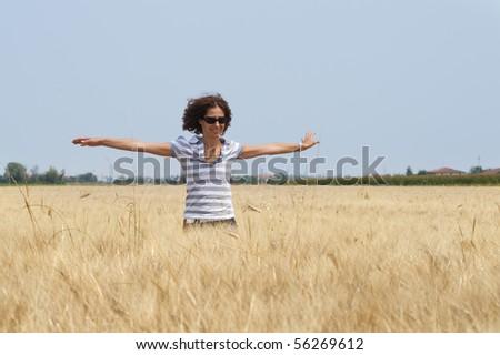 Woman in a cornfield.
