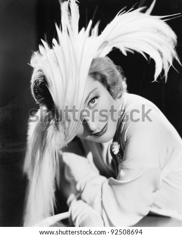 Woman in a dramatic feather hat