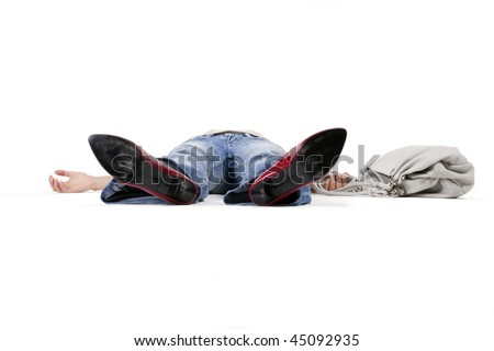 stock photo : Woman in a faint lying on the floor holding a bag.
