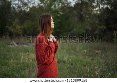 woman in a forest in a beautiful sweater resting in the fresh air #1513899158