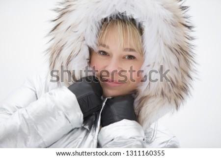 Woman in a furry furry hood #1311160355