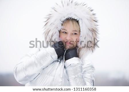 Woman in a furry furry hood #1311160358