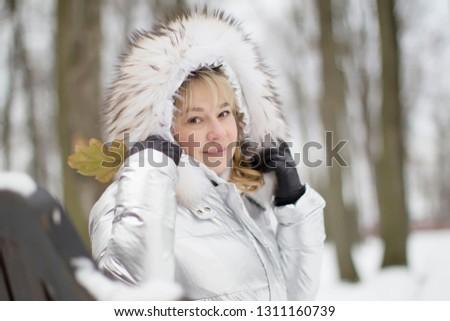 Woman in a furry furry hood #1311160739