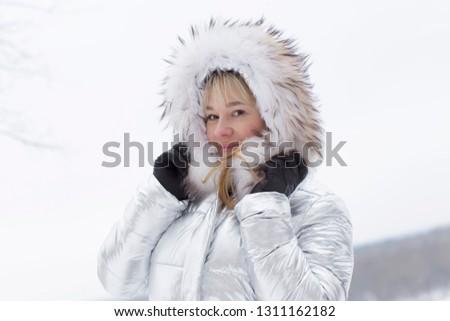 Woman in a furry furry hood #1311162182