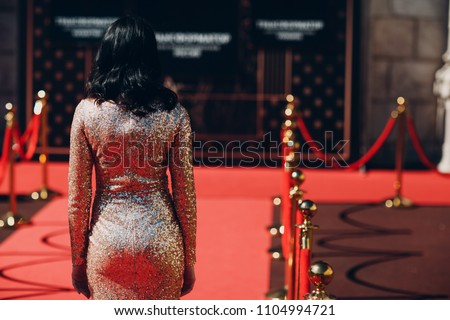 Woman in a luxurious dress on a red carpet #1104994721