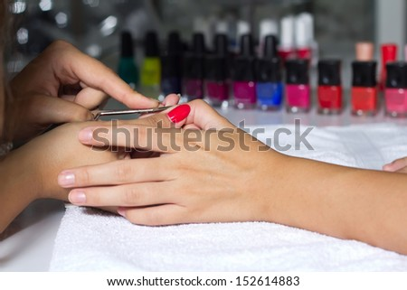 Woman in a nail salon receiving, maintenance of hygiene nails