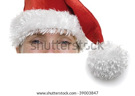 Woman in a santa hat with a sign in front of her with plenty of copyspace