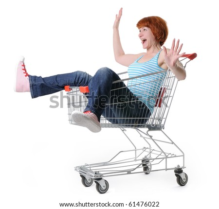 Woman in a shopping cart on withe background