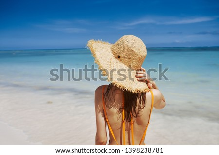 woman in a straw hat bikini beach vacation Exotic Caribbean islands summer sun travel #1398238781