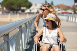 woman in a wheelchair on a pier