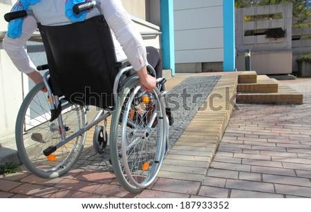woman in a wheelchair using a...