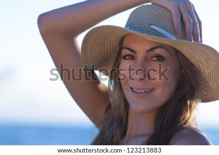 Woman in a yellow dress at the beach.