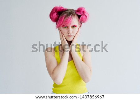 woman in a yellow shirt with pink hair #1437856967