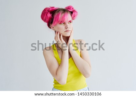 woman in a yellow shirt with pink hair #1450330106
