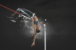 Woman in action of high jump on black background. Sports banner. Horizontal copy space background