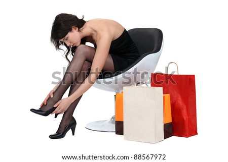 Woman in armchair with shopping