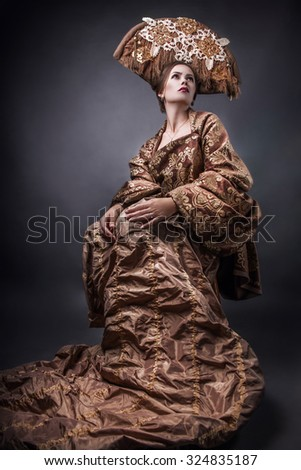 Woman in authentic designer outfit