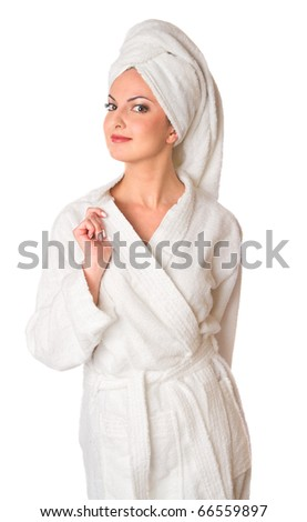 Woman in bathrobe is smiling. Isolated at white